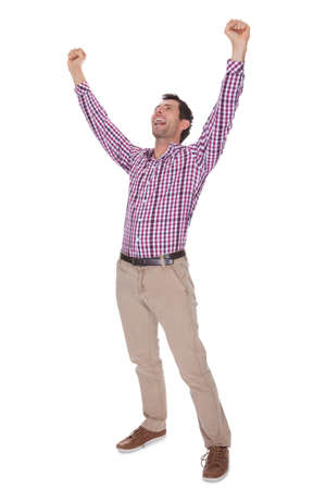 Portrait Of Young Man Cheering Isolated On White Background photo