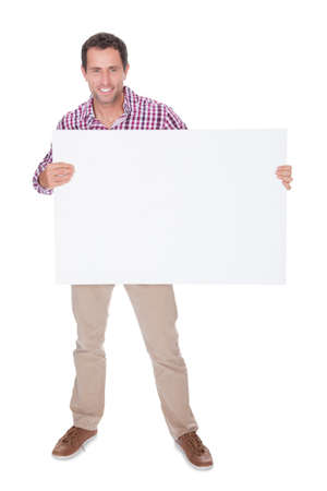 happy young man: Portrait Of Young Man Holding Placard Isolated On White Background