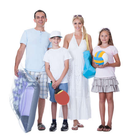 Happy Family With Two Children Ready For Vacation Isolated On White Background