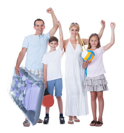 Happy Family With Two Children Ready For Vacation Isolated On White Background photo