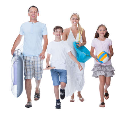 beach front: Happy Family With Two Children Ready For Vacation Isolated On White Background