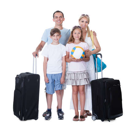 Happy Family With Luggage Going For Vacation Isolated On White Background photo