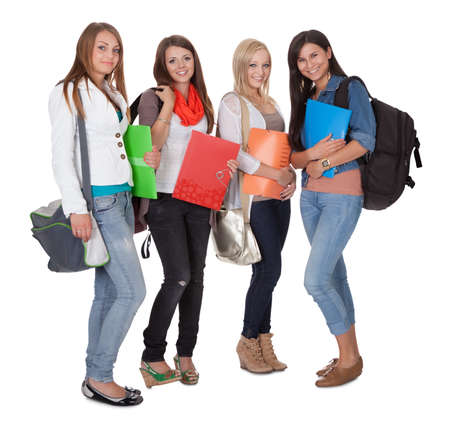 Studio shot of four female students isolated on white Stock Photo - 15720002