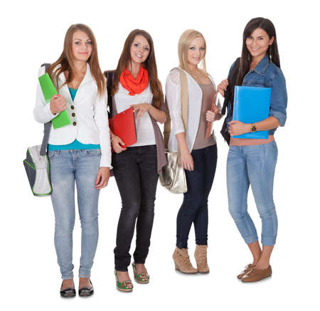 satchel: Studio shot of four female students isolated on white