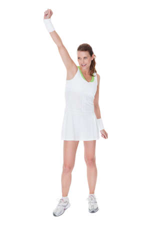 Young woman tennis player in a short white tennis dress isolated on white photo