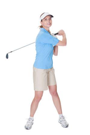 Golfista femenino atractivo en la ropa de golf con un palo de golf aislado en blanco Foto de archivo - 16336584