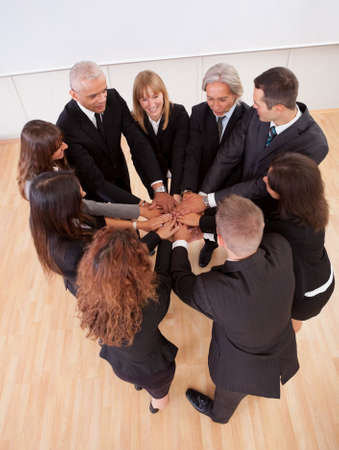 High angle view of a diverse group of people in a business team with their hands one on top of the other photo