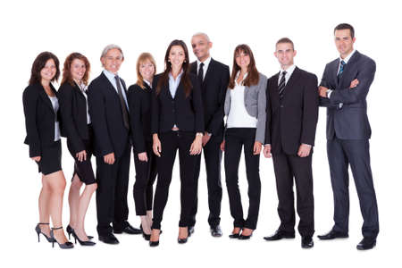 committed: Lineup of diverse professional business executives or partners standing relaxed in a row isolated on white Stock Photo