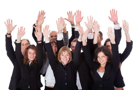 High angle view of a diverse group of business people waving in acknowledgment of an accolade isolated on white photo