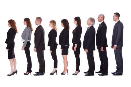side pose: Long line of diverse professional business people standing in a queue in profile isolated on white
