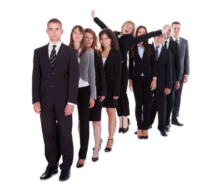individual: Businesswoman standing out from the crowd of her colleagues displaying individuality isolated on white