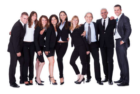 Lineup of diverse professional business executives or partners standing relaxed in a row isolated on white Stock Photo