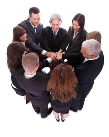 pledge: High angle view of a diverse group of people in a business team with their hands one on top of the other