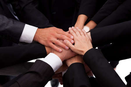 High angle view of a diverse group of people in a business team with their hands one on top of the other Stock Photo - 16426524