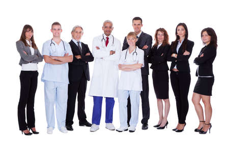 medical team: A happy group photo depicting a group of staff people. Isolated on white