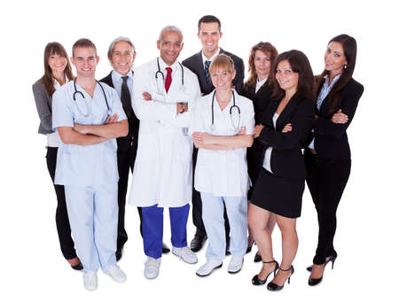 medical staff: A happy group photo depicting a group of staff people. Isolated on white