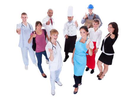 diferentes profesiones: Un grupo grande de personas que representan diversas profesiones incluyendo Foto de archivo