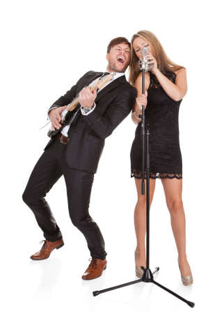 Couple performs duet sharing same microphone to everybody. photo