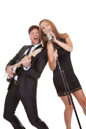 sexy guitar: Couple performs duet sharing same microphone to everybody.