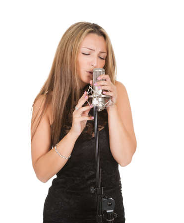 vocalist: Beautiful female singer with a microphone isolated on white Stock Photo