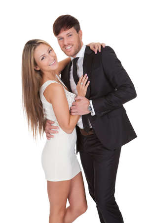 elegant couple: Portrait of elegant young couple. Isolated on white