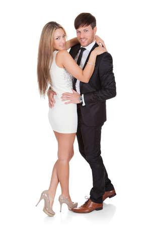Young elegant couple dancing. Isolated on white Stock Photo - 16522708