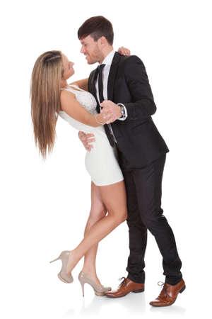 miniskirt: Young elegant couple dancing. Isolated on white