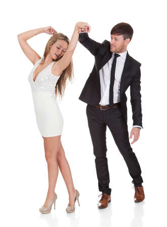 dancing pose: Young elegant couple dancing. Isolated on white
