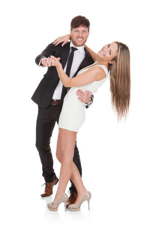 Young elegant couple dancing. Isolated on white photo