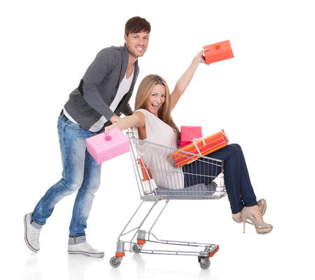 Woman carried by push cart held by man. Stock Photo - 16522588