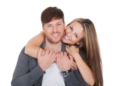 Studio shot of happy young couple isolated on white Stock Photo - 16522541