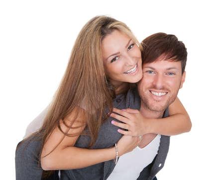 Studio shot of happy young couple isolated on white Stock Photo - 16522517