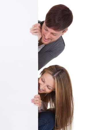 Sports fans popped their heads out from white wall. Stock Photo - 16521996