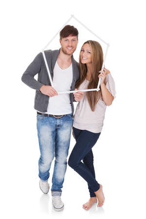 Smiling attractive young couple posing standing close together on a white background Stock Photo - 16522624