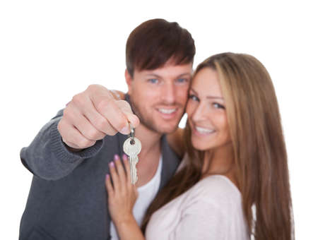 Big key for new condominium held by boyfriend. Stock Photo - 16522367