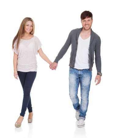 Sweet partners hold each others' hands while walking. Stock Photo - 16522581