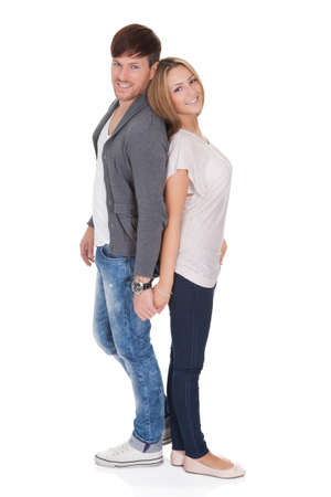 Attractive young couple holding their hands isolated on white Stock Photo - 16522443
