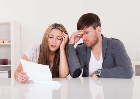 issues: Shock portrayed on mans face after reading letter. Stock Photo