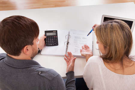 tax bills: Couple argue about money especially house expenses.