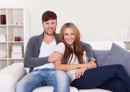 Couple sit on new couch bought at furniture shop. Stock Photo - 16522094