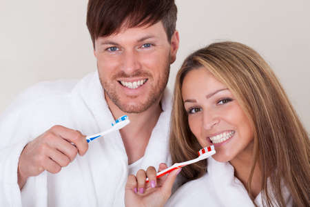 They brushed teeth together before taking shower. Stock Photo - 16521959