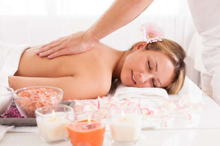 aromatherapy oils: Client relaxing in massage at the spa Stock Photo