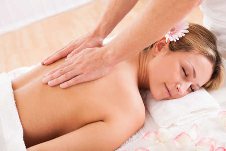 back massage: Client relaxing in massage at the spa Stock Photo