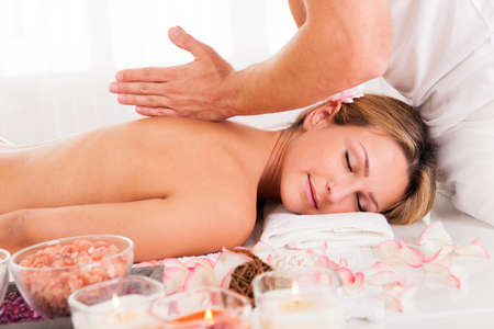 shiatsu: Client relaxing in massage at the spa Stock Photo