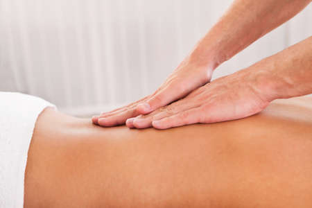 massage therapy: Client relaxing in massage at the spa Stock Photo