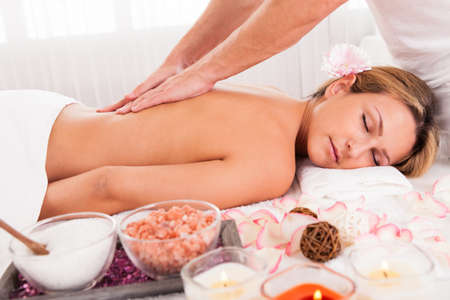 pressure massage: Client relaxing in massage at the spa Stock Photo