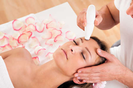 laser treatment: Young attractive woman undergoes microdermabrasion therapy in spa setting