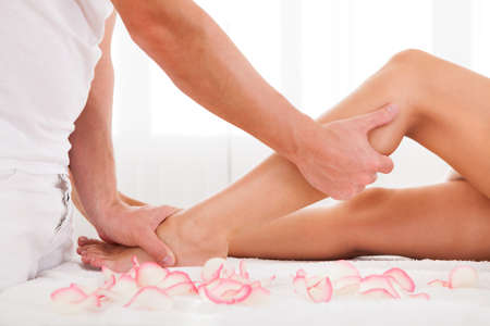 pressure massage: Stressed toes needs to relax after busy work week. Stock Photo