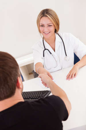 Doctor writing down prescription for sick client. Stock Photo - 16522596