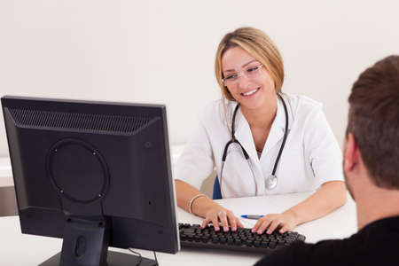 Physician explains the procedure before doing this to him. Stock Photo - 16522030